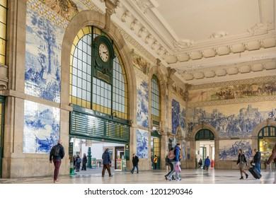 Porto, Portugal - January 12, 2018: People in the vestibule of Sao Bento Railway Station. It is decorated with approximately 20,000 azulejo tiles, dating from 1905-1916