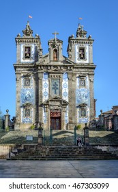 PORTO, PORTUGAL, JANUARY 2, 2016: Church of Saint Ildefonso (Igreja de Santo Ildefonso) with a man sitting in front in PORTO