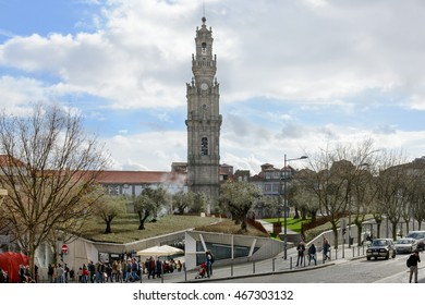 PORTO, PORTUGAL, JANUARY 2, 2016: The Clerigos Tower (Torre dos Clerigos) behind crowded city center in PORTO