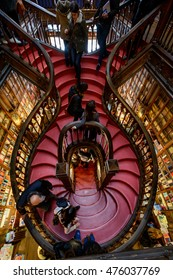 PORTO, PORTUGAL, JANUARY 2, 2016: The famous staircase and daily visitors inside the Lello e Irmao Bookstore in PORTO
