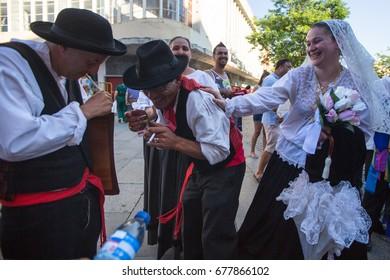 PORTO, PORTUGAL - JUL 15, 2017: Participants of the Porto folklore festival (Festival de Folclore do Orfeao do Porto).