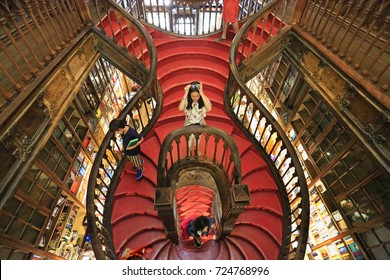 PORTO, PORTUGAL - JULY 07, 2017: High angle view of stairs inside the famous bookshop Lello e Irmao (1906), considered as one of the most beautiful bookstores in the world.