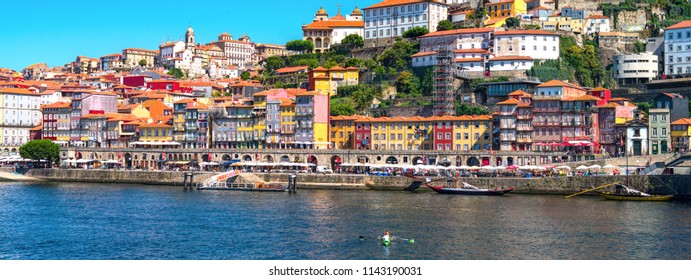 PORTO, PORTUGAL - JULY 22, 2018:  View of the Ribeira Neighborhood and the Douro River in the city of Porto, Portugal
