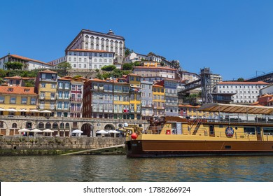 PORTO, PORTUGAL - JULY 5, 2020: the famous houses of the Ribeira in the Douro River bank near the Dom Luis I Bridge, Porto, Portugal.
