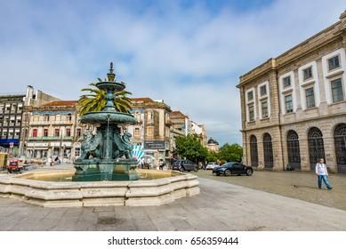 PORTO, PORTUGAL - JUNE 12, 2016: Fonte dos Leoes (Fountain of the Lions) in the Historic Centre of Porto, Portugal. The Historic Centre of Porto is a UNESCO World Heritage Site.