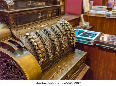 PORTO, PORTUGAL - JUNE 12, 2016: Antique cash register machine in the Livraria Lello & Irmao bookstore in Porto, Portugal. The bookstore is frequently rated among the top bookstores in the world.