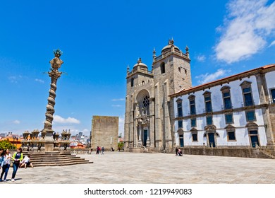 PORTO, PORTUGAL - JUNE 19, 2013: Facade view of Porto Cathedral (Portuguese: Se do Porto) in historic center of Porto city, Portugal. Built in 12th century. Unesco World Heritage Site