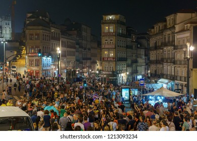 PORTO, PORTUGAL - JUNE 23 2018: Crowds in the streets of Porto during the Festa de São João do Porto festival, one of Europe's liveliest street festivals.
