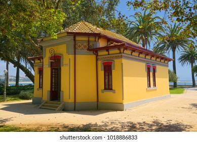 PORTO, PORTUGAL - JUNE 5, 2015: Picturesque yellow building of public restroom in Jardim do Passeio Alegre garden, located at western side of Porto city.