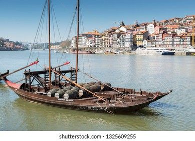 "PORTO, PORTUGAL - MARCH 11, 2014: Oporto city,  ""Rebelo"" Boats in the river (Douro) near the old city and the ""D. Luis"" bridge, Portugal."