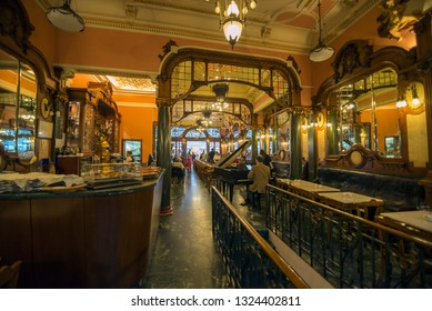 PORTO, PORTUGAL - MARCH  11: People at the Majestic Cafe on March 11, 2014. The Old-fashined Majestic Cafe is the best know Cafe in Porto old downtown.