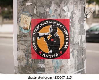 Porto, Portugal - March 6th 2019: Red Antifa sticker on a lamp post in Porto city