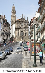 Porto, Portugal - May 12, 2012: Old street (Rua dos Clerigos) and Clerigos Church in downtown of Porto