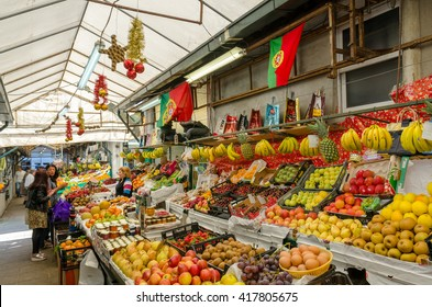PORTO, PORTUGAL - MAY 19, 2015: Customers buying fruits in the Bolhao Market.