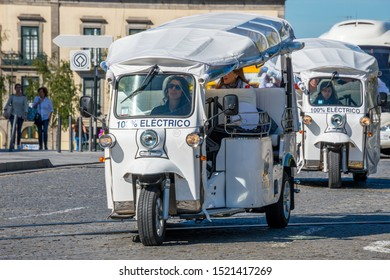 Porto, Portugal - May 19, 2017: Tuc-tuc vehicles circulating through a neighborhood in the historic city center