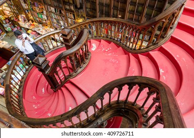 PORTO, PORTUGAL - MAY 20, 2015:  An unidentified man takes photo of the staircase at the Lello & Irmao bookstore.