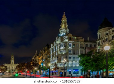 Porto, Portugal - May 30, 2018: Night view of Edificio BBVA or Edificio Pinto Leite and City hall with light trails on Avenida dos Aliados