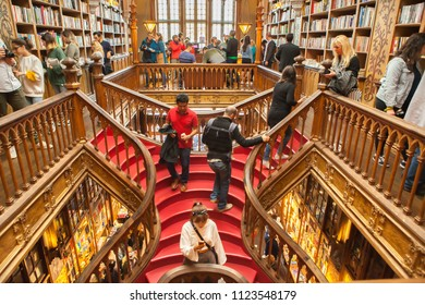 Porto, Portugal - May 31, 2018: large wooden staircase with red steps inside Library Lello and Irmao, one of the world's most beautiful bookstore in historic center, famous for Harry Potter film.