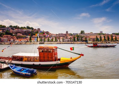 PORTO, PORTUGAL - MAY 5, 2011: Douro river with rabelo boats view from the Ribeira river walk