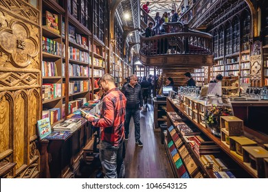 Porto, Portugal - November 13, 2017: People buys books in Lello Bookstore in Porto, considered to be one of the most beautiful bookstores in the world
