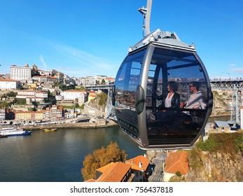 PORTO, PORTUGAL - November 9, 2017: The cabin of the funicular Teleférico de Gaia with the Douro river and Dom Luis I bridge in the background, Porto, Portugal