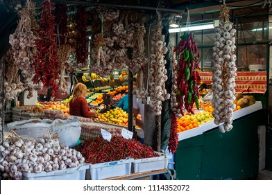 Porto, Portugal - October 10, 2010: People buying products at the traditional Bulhao Market (Mercado do Bolhao) in the city of Porto, Portugal