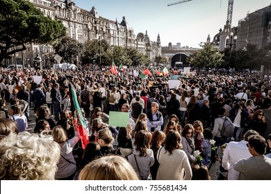"""PORTO, PORTUGAL - OCTOBER 20, 2017: Huge protest and public manifestation of people against the Portuguese policies of prevention to the firewoods in the """"Avenida dos Aliados""""."""