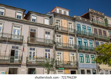 PORTO, PORTUGAL - OCTOBER, 2016: cityscape. view of typical tiled homes facade in Ribeira, the old town of Porto, Portugal
