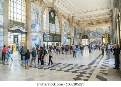 PORTO, PORTUGAL - OCTOBER 31, 2017: People in the vestibule of Sao Bento Railway Station,  decorated with approximately 20,000 azulejo tiles, in Porto, Portugal