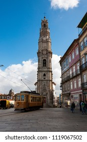 Porto, Portugal - October 4, 2010: Street scene in the city of Porto with an old tram in front of the Clerigos Tower, in Portugal