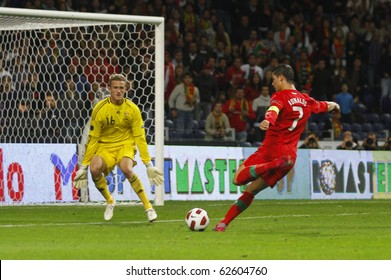 PORTO, PORTUGAL - OCTOBER 8: Cristiano Ronaldo (POR) about to score Portugal's 3rd goal on the Euro2012 Qualifying match against Denmark on October 8, 2010 in Porto, Portugal
