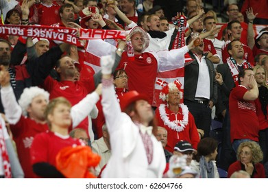 PORTO, PORTUGAL - OCTOBER 8: Danish (Dane) supporters encourage their National Team in the Euro 2012 Group Stage Qualifying match against Denmark on October 8, 2010 in Porto, Portugal
