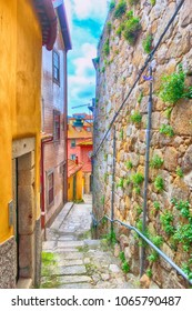 Porto, Portugal old town narrow street perspective view with colorful traditional houses