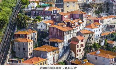 PORTO, PORTUGAL, on June 15, 2017. Summer day. The sun lights red roofs of in downtown on a hill slope on the river bank of Douro