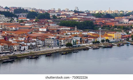 PORTO, PORTUGAL, on June 17, 2017. The sunset sun lights the embankment on the opposite bank of the river of Duero. People move on the embankment