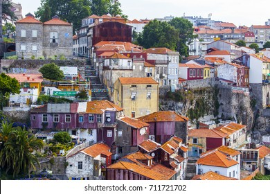 PORTO, PORTUGAL, on June 17, 2017. The sun lights facades of picturesque old authentic houses in a historical part of the city on the high bank of the river of Duero