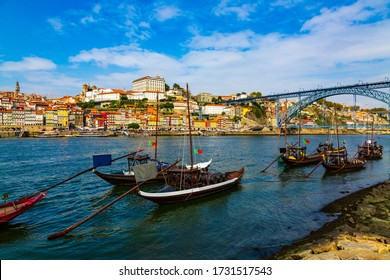 Porto, Portugal, Riberia old town cityscape with Dom Lusi bridge and the Douro River with traditional Rabelo boats