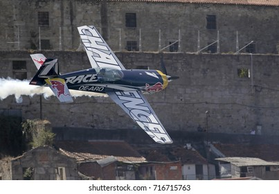 Porto, Portugal - September 1, 2017: Red Bull air race. Training day. Airplane in a tight maneuver on the Vila Nova de Gaia bank of the Douro river.