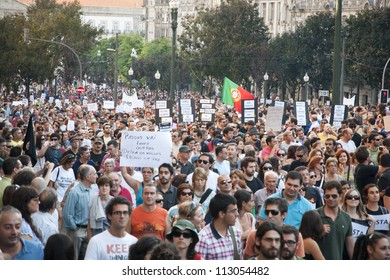 PORTO, PORTUGAL - SEPTEMBER 15: People protesting against government spending cuts and tax rises in Aliados square, Porto on September 15, 2012 in Porto, Portugal