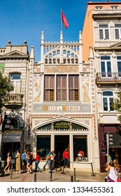 PORTO, PORTUGAL - September 2, 2016: Pedestrians are passing by in front of the famous old Livraria Lello bookstore in Porto, Portugal, listed as the most beautiful bookstore in the world