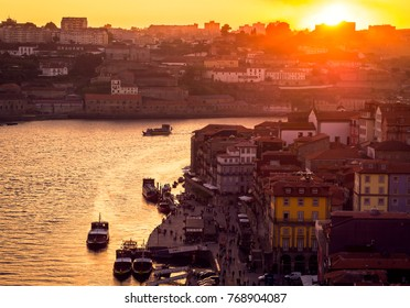 PORTO, PORTUGAL - SEPTEMBER 23, 2017. Aerial view of Douro river and city of Porto during sunset.