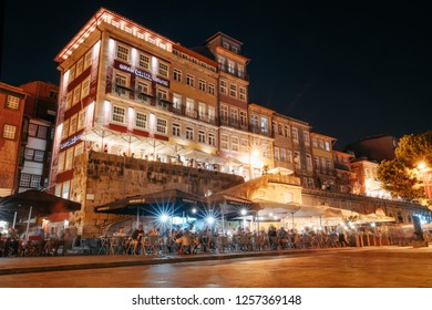 Porto, Portugal - September 27, 2018: Porto, Nightlife on the crowded promenade of the Douro River with cafes and restaurants in Porto