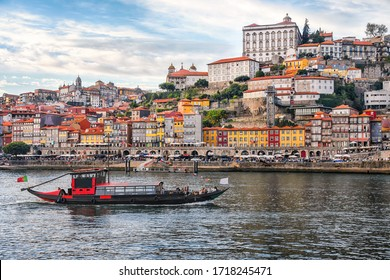 Porto, The Ribeira District, Portugal old town, ribeira aerial promenade view with traditional facades of colorful houses, Douro river and boats.