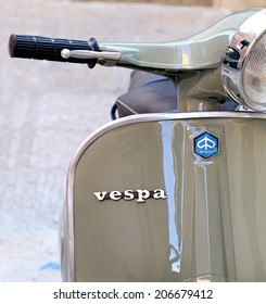 PORTO SANTO STEFANO, ITALY - JULY 18, 2014: classic Vespa is one of the products of the industrial design world's most famous and most often used as a symbol of Italian design. Tuscany - Italy