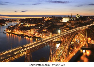 Porto skyline and Douro River at night with Dom Luis I Bridge on the foreground, Portugal