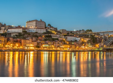 Porto Skyline at dusk view from the southern shore of the Douro river, Portugal