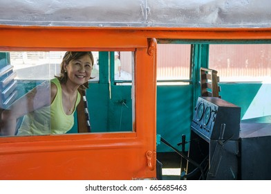 PORTO VELHO, BRAZIL - JUNE 16, 2017: Madeira-Mamore station and the reactivation of the litorina tour on Estrada de Ferro Madeira Mamore railroad in Porto Velho RO. Woman inside litorina.