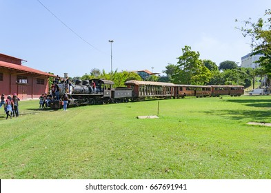 PORTO VELHO, BRAZIL - JUNE 16, 2017: Children visiting the open air museum Estrada de Ferro Madeira-Mamore in Porto Velho. Old trains that were abandoned are now tourist attractions on EFMM square.