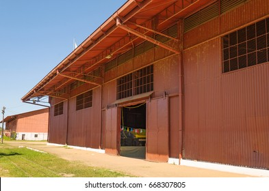 PORTO VELHO, BRAZIL - JUNE 16, 2017: Big red hangar on Estrada de Ferro Madeira-Mamore. Today, the old train hangar has some shops with local stuff and local culture inside.