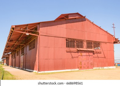 PORTO VELHO, BRAZIL - JUNE 16, 2017: Big red warehouse on Estrada de Ferro Madeira-Mamore. Today, the old train warehouse has some shops with local stuff and local culture inside for tourists.
